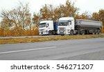 two big trucks on road