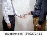 Small photo of Corrupted man paying a Dollars banknotes bribe to a businessman, or politician, accepting corruption