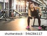 young sportswoman lifting... | Shutterstock . vector #546286117