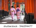 Stock photo women in traditional japanese clothes kimono are in the gallery of red shinto shrine gate 546394477