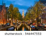 Stock photo view of a church and a canal in amsterdam netherlands at night 546447553