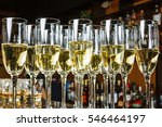 glasses filled with champagne.... | Shutterstock . vector #546464197