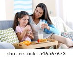 mother and daughter having... | Shutterstock . vector #546567673