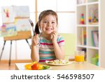 child little girl with fork... | Shutterstock . vector #546598507