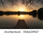 dock on the lake at sunset near ... | Shutterstock . vector #546624967