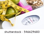 Small photo of scale with cereals, fruit, weight and tape measure and concept of diet and healthy lifestyle
