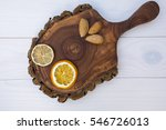dried oranges with almonds on... | Shutterstock . vector #546726013