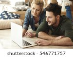 young couple in new flat using... | Shutterstock . vector #546771757