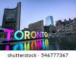 Stock photo toronto city hall and toronto sign in downtown at twilight in toronto ontario canada 546777367