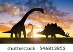 Silhouette Of Dinosaurs In The...