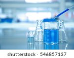 blue drop into glass beaker... | Shutterstock . vector #546857137