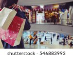 Woman Holding Shopping Bags In...