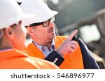 supervisor showing something to ... | Shutterstock . vector #546896977