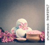 Small photo of Spa salt, stones and bath bomb, flower branch for beauty and health. Healthy relaxation, therapy and treatment. Aromatherapy, body care, aroma massage. Alternative lifestyle.