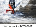 Man Operating Snow Blower To...