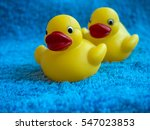 Rubber Ducks Sitting On A Blue...