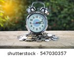 Alarm Clock And Money Coin On...