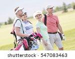 happy friends walking at golf... | Shutterstock . vector #547083463