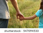 the parent holds the hand of a... | Shutterstock . vector #547094533