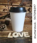 Small photo of winter love coffee to go . take away white cup with wooden word love. winter coffee
