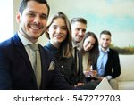smiling employee's in a line at ... | Shutterstock . vector #547272703