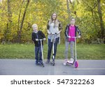 happy family riding scooters... | Shutterstock . vector #547322263