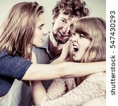 Small photo of Aggressive mad women fighting over man. Young jealous girls wooing guy. Violence.