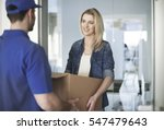 woman getting a parcel from... | Shutterstock . vector #547479643