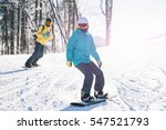 skiers couple skiing in the... | Shutterstock . vector #547521793
