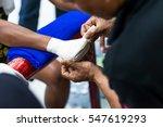 muay thai fighter putting... | Shutterstock . vector #547619293