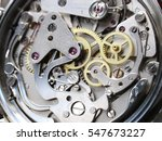 Small photo of clock mechanism close-up view