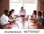mature businessman addressing... | Shutterstock . vector #547735507