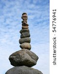 Zen stones with blue sky - stock photo