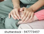 nurse holding the hand of an