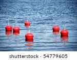 Red buoys in the sea - stock photo
