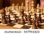 Wooden Chess Pieces On A...