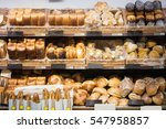 focus on shelves with bread in... | Shutterstock . vector #547958857