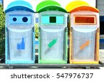 Three Colorful Recycle Bins...