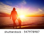 mother and son relaxing on the... | Shutterstock . vector #547978987