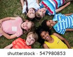 happy children lying on grass... | Shutterstock . vector #547980853