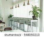 empty wood chair in restaurant | Shutterstock . vector #548050213
