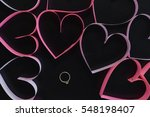 Gold Ring Among Pink Hearts