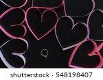 Gold Ring Among Pink Hearts