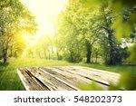 wooden table in garden of...   Shutterstock . vector #548202373