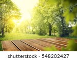 wooden table in garden of... | Shutterstock . vector #548202427