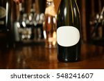 Wine Bottle On Wooden Table At...