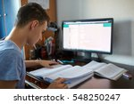 teenager boy doing homework on... | Shutterstock . vector #548250247