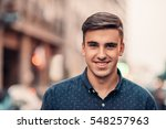 handsome young man smiling on a ... | Shutterstock . vector #548257963