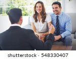 smiling young couple in meeting ... | Shutterstock . vector #548330407