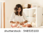 mother changing a diaper on...   Shutterstock . vector #548535103